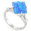 Золотое кольцо с голубым синтетическим опалом SL-0255-322 весом 3.2 г  стоимостью 14400 р.